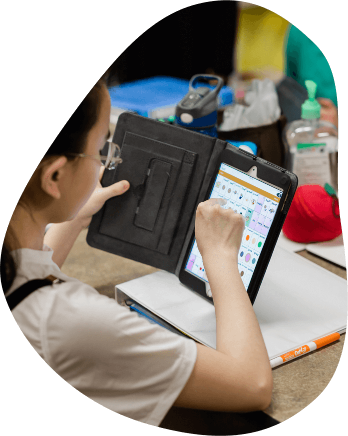 Image of a girl using the Touch Chat App on an iPad